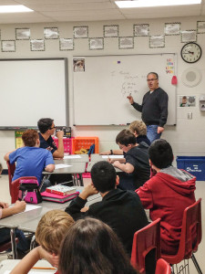 Pastor Chris Brauns teaching Writing to 7th Graders in Stillman Valley